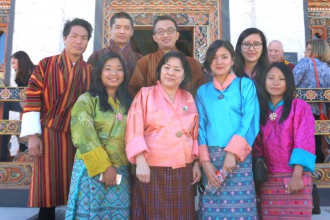 Kunzang C. Namgyel poses with Bhutanese students at the unveiling of the Lhakhang.