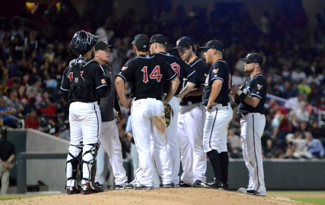 Chihuahuas manager Pat Murphy talks to his players during a trip to the mound.