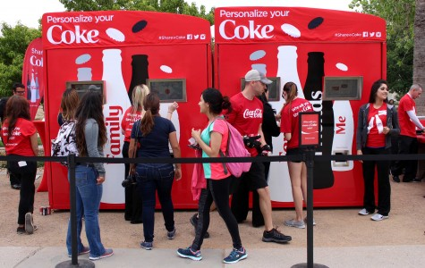 UTEP students personalize their coke cans near Leech Grove.