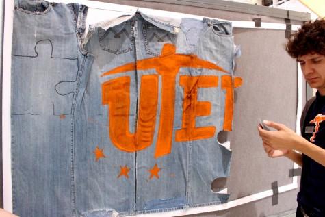 A UTEP student prepares a denim board.