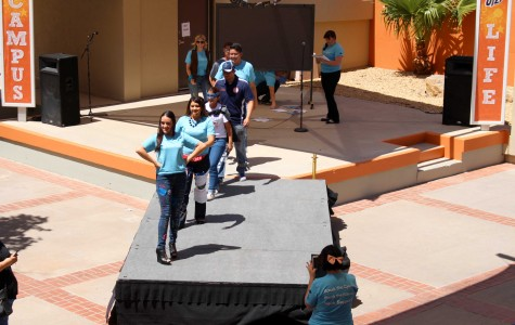 Participants of Denim Day Fashion Show walk on the runway.