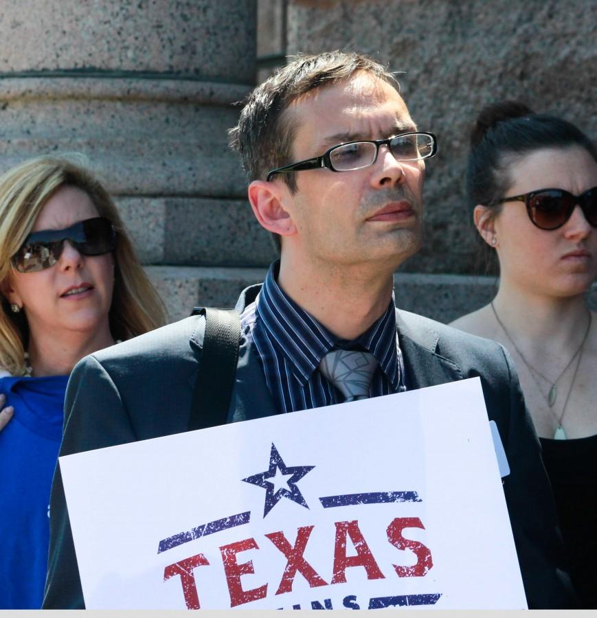 A participant at Freedom Advocacy Day listens to Chuck Smith, executive director of Equality Texas, speak.