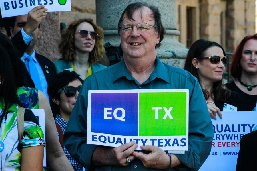 A participant at Freedom Advocacy Day holds up an Equality Texas sign.
