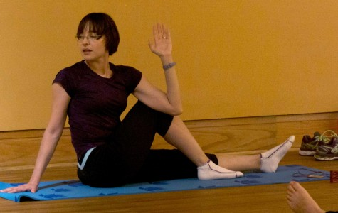 Doctoral candidate, Maricarmen Vizcaino demonstates the yoga she teaches to UTEP faculty and staff members.