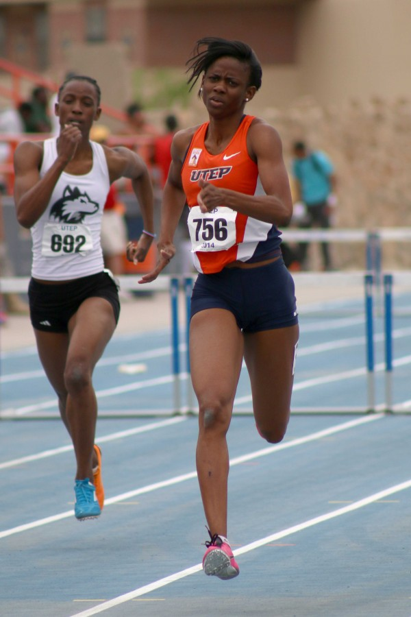 UTEP Senior hurdler Anna-Kay James sprints to the finish line.