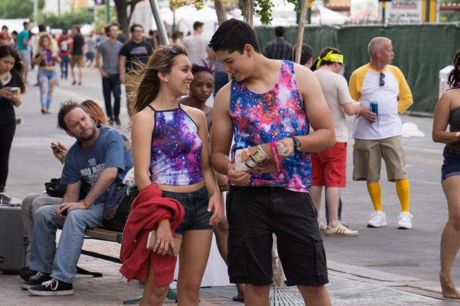 A matching couple shares a laugh white at Neon Desert Music Festival 2015.