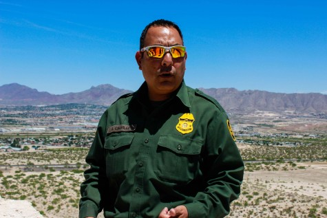 Adrian Calvillo, Border Patrol Agent, speaks to UTEP students about the border fence.