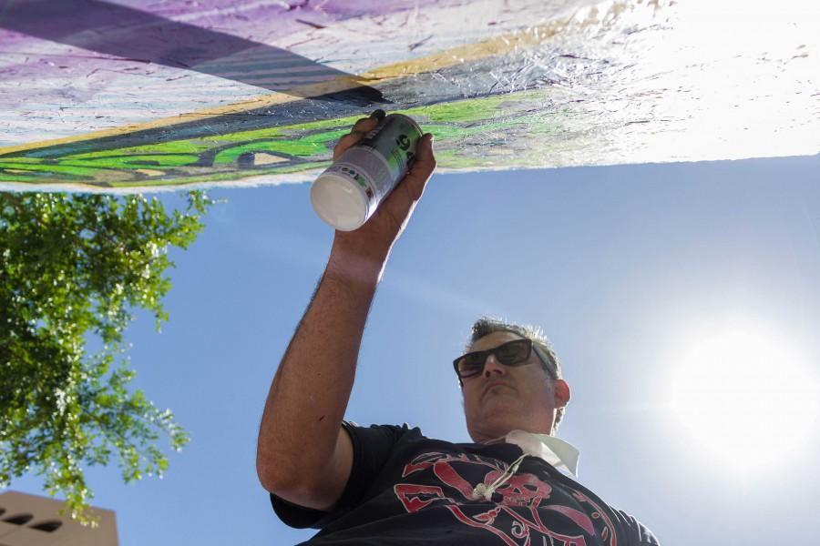 Artist+Grave+Herrera+paints+the+Neon+Desert+board.+