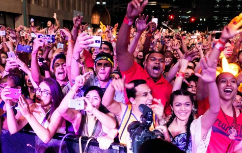 Concert goers watch J Cole perform at Neon Desert Music Festival in 2015.