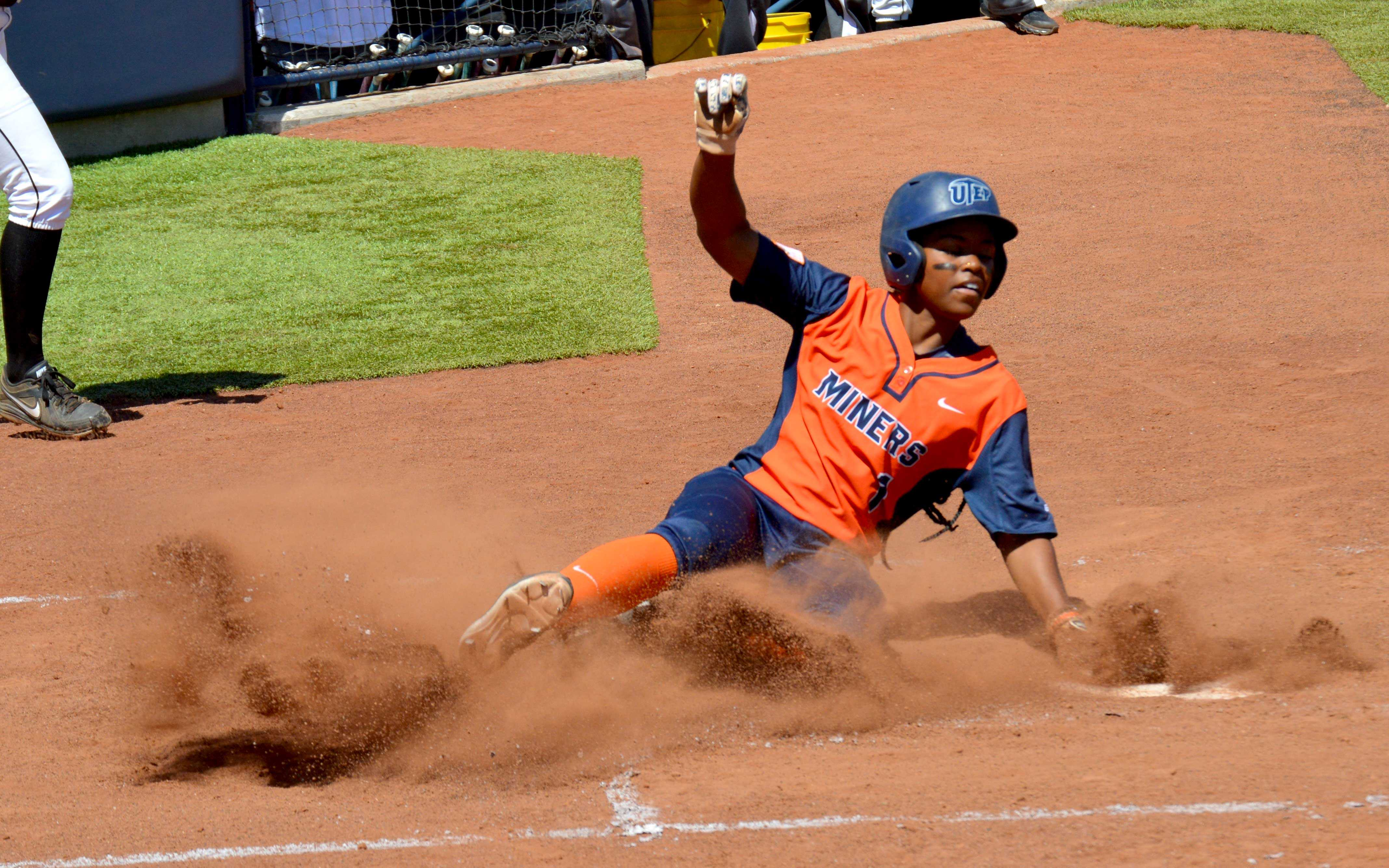 Senior outfielder Tahla Wade slides into home during a game at the Helen of Troy Softball Complex.