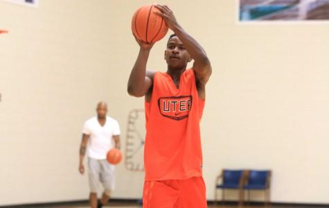 Junior guard Dominic Artis shoots the ball at the Foster Stevens Basketball Center.
