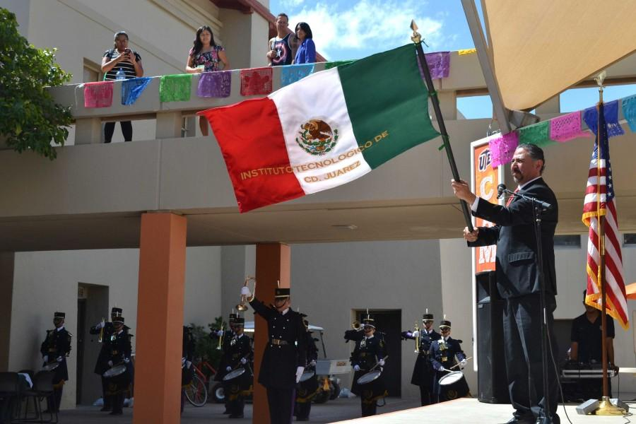 Consul General of Mexico in El Paso Jacob Prado waves the Mexican flag after performing