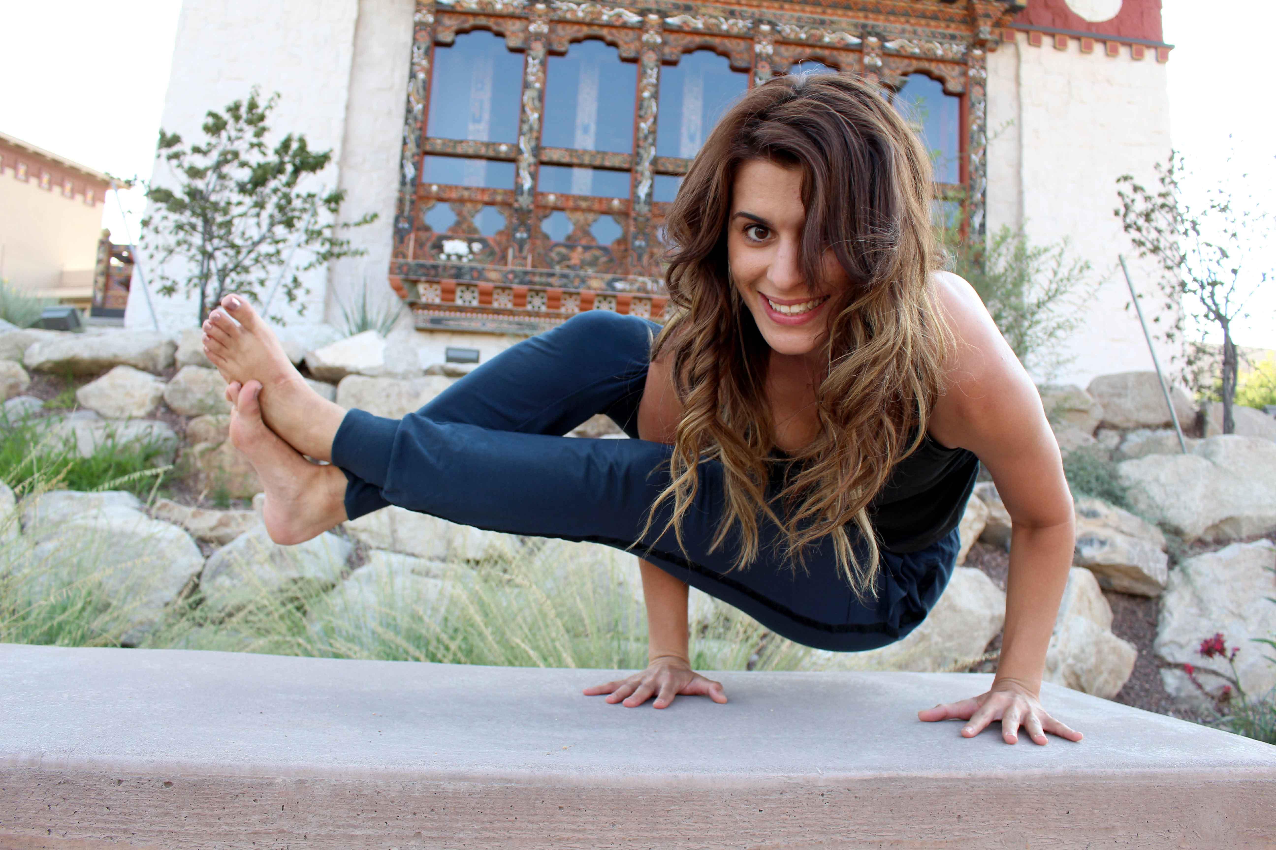Education graduate student, Rasmiyeh Asam demonstrates one of the yoga poses she teaches.
