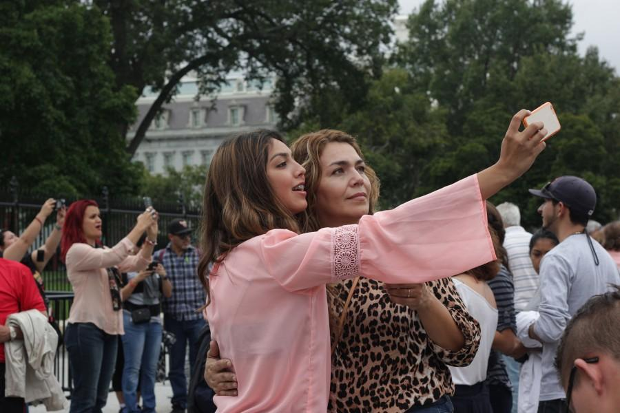 amanda guillen/ SHFWIRE Crystal Zapata, 19, takes a selfie Tuesday with her mother, Lourdes Zapata, 39, in front of the White House