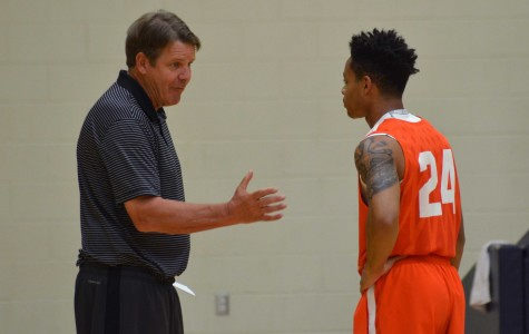 UTEP men's basketball head coach Tim Floyd instructs freshman guard Tedric Johnson during a Monday practice.