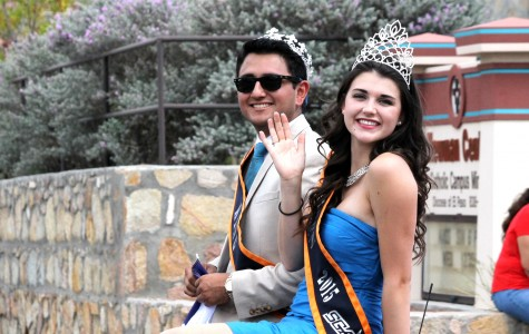 UTEP's king and queen riding through the parade