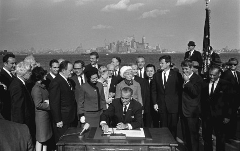 President Lyndon B. Johnson signs the Immigration and Nationality Act of 1965 on Oct. 3, 1965. This act abolished the national quota system and changed the demographic makeup of the United States.