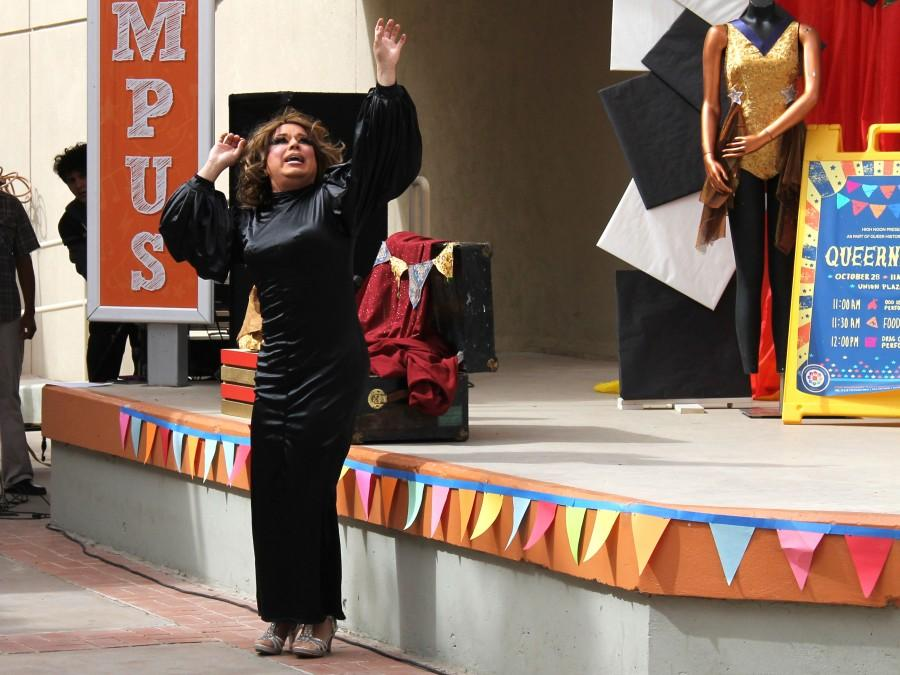 A local drag queen lip-synced to a disco medley during 'Queernival' on Oct. 28 at the Union breezeway.