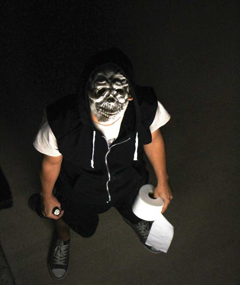 A male student poses as someone that may participate in halloween vandalism.