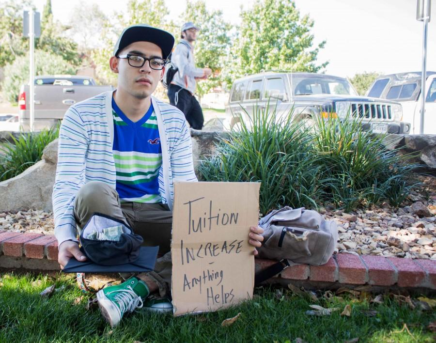 Freshman philosophy major Jorge Martinez poses as a student struggling from tuition increase.