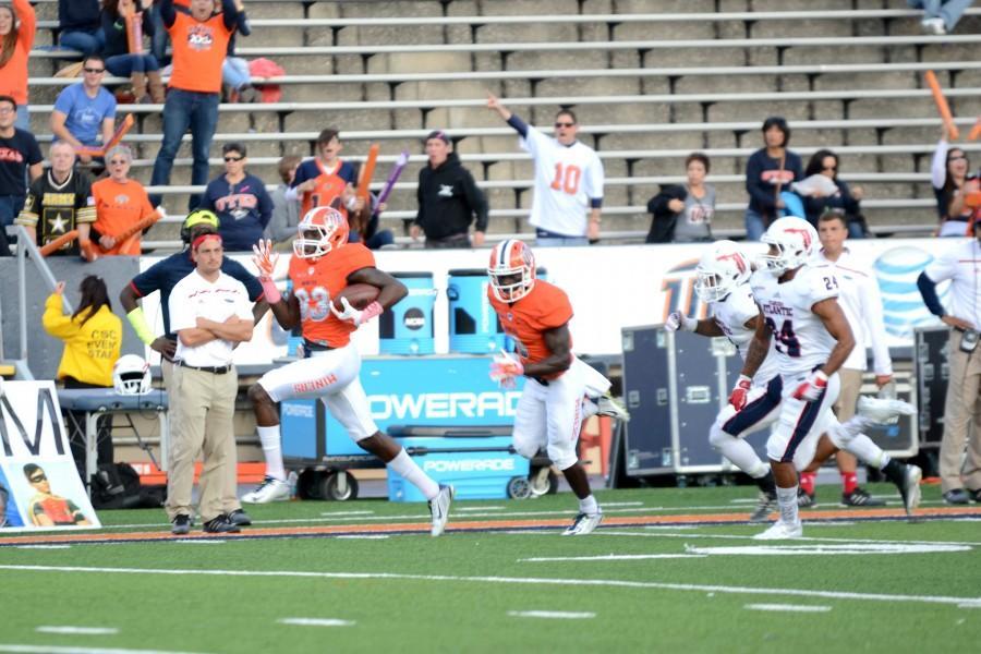 Senior wide receiver Tyler Batson runs toward the end zone.