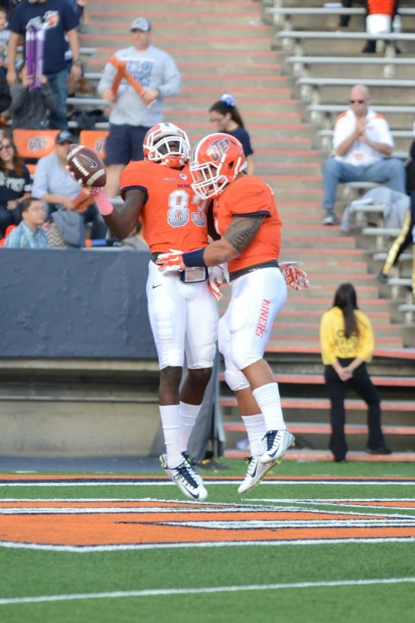 Senior Tyler Batson celebrates the first touchdown of the game with a fellow teammate.