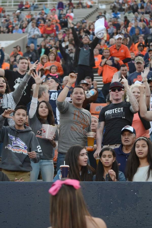 UTEP Miner fans react as a free shirt is throw at them.