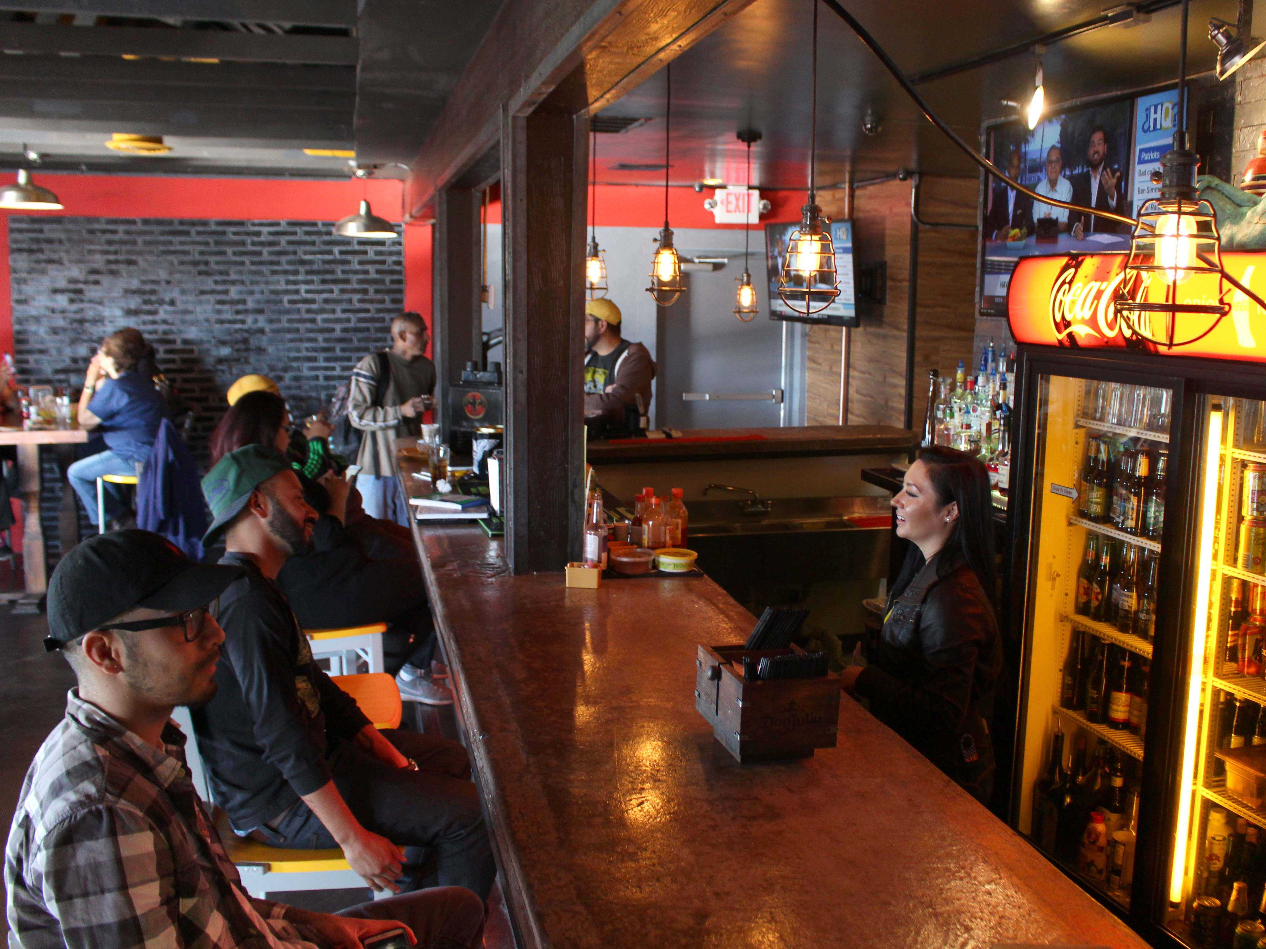Customers enjoy spending their time at BarMen, a new bar/restaurant that serves tacos and other traditional Mexican dishes.