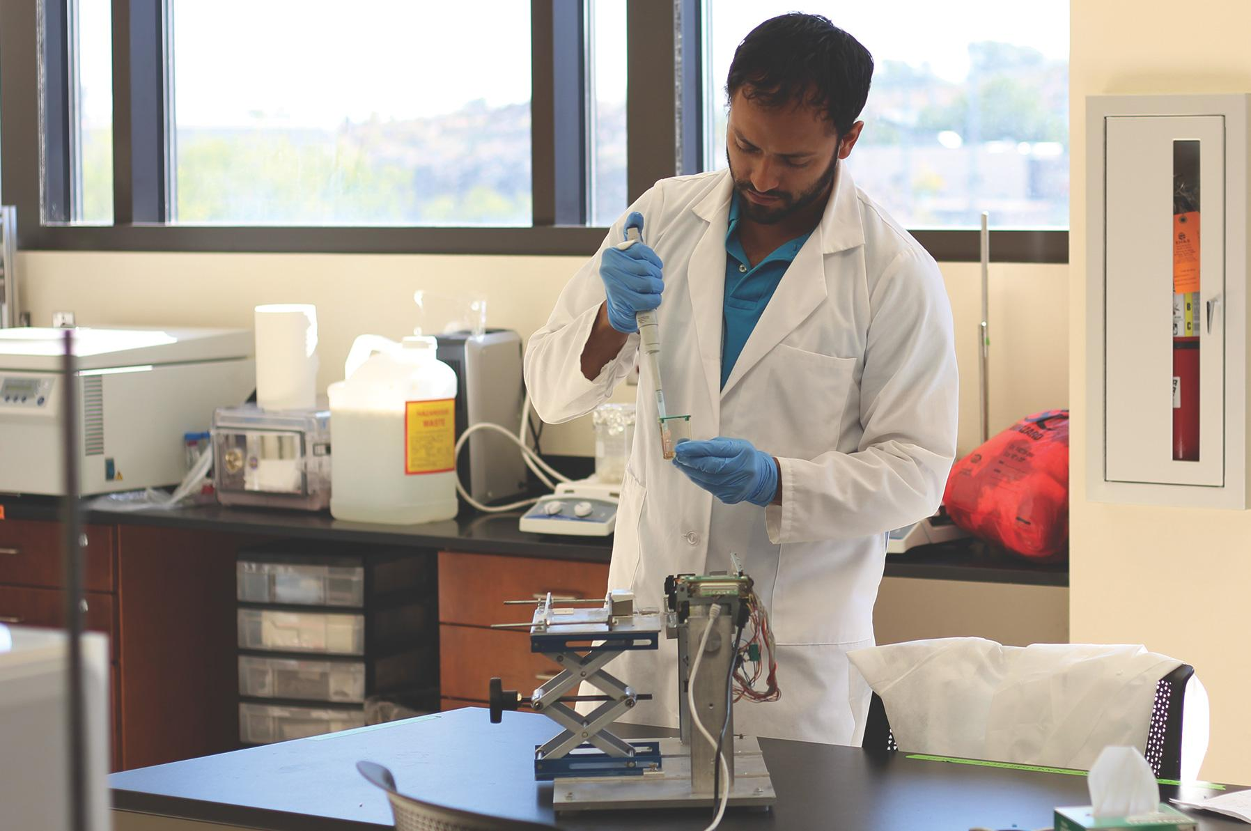 Doctoral biomedical engineering student, Julio Rincon helped develop a new device that helps HIV patients monitor their health quickly and at a low cost.