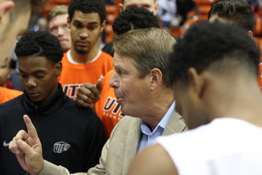 Coach Tim Floyd speaks with his players before the game versus Alcorn.