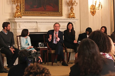 Andrew Lloyd Webber talks to the students about his career after playing a impromptu medley on the State Dining Room piano.