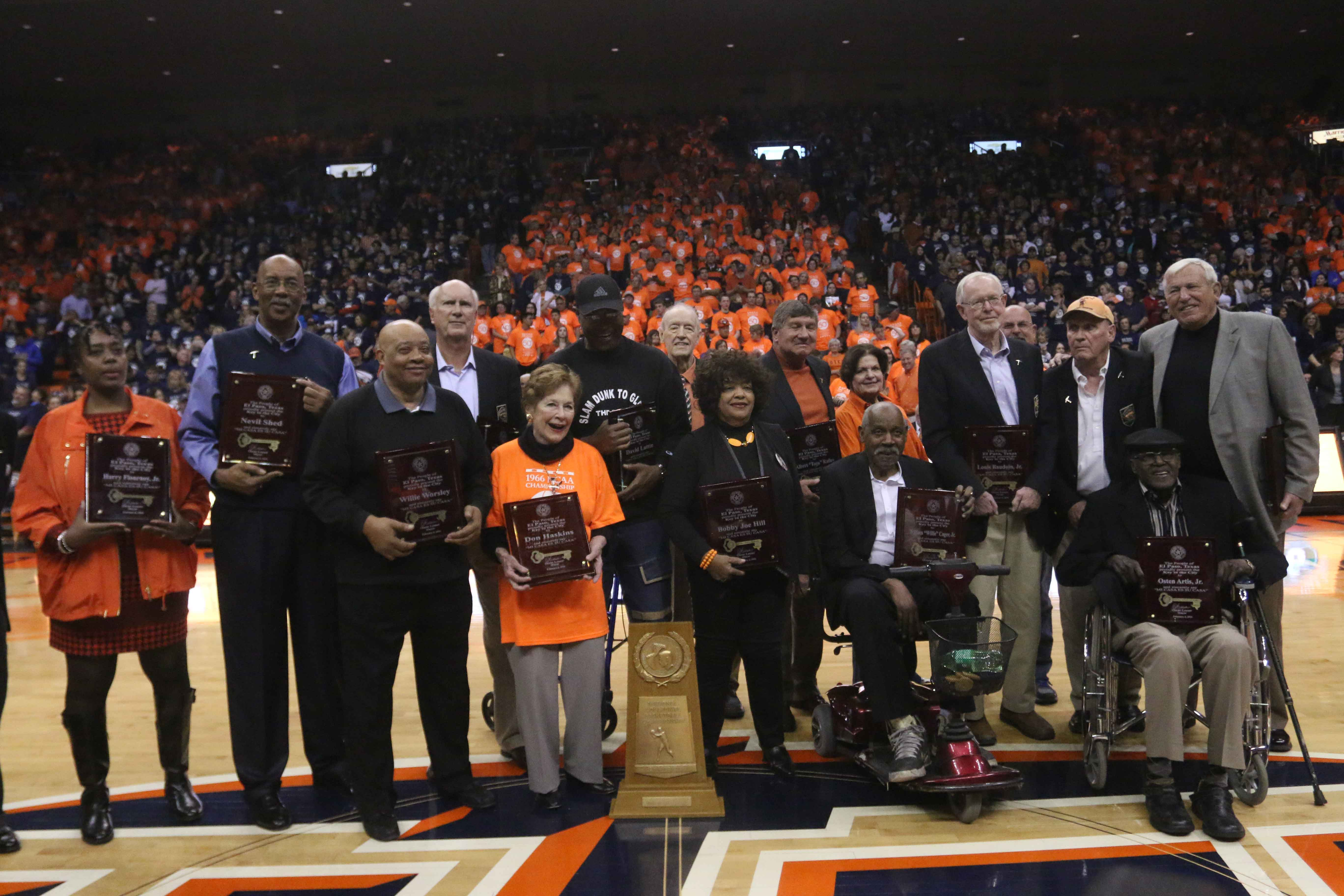 Members of the 1966 basketball team and family members gather at the Don Haskins Center.