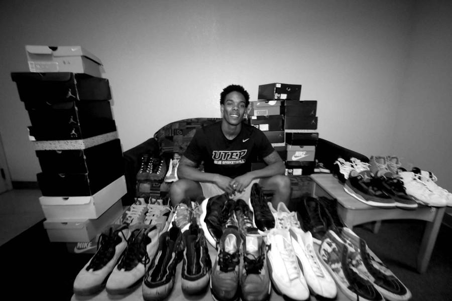 Shooting guard Omega Harris shows off his extensive shoe collection, which is housed in his dorm room.