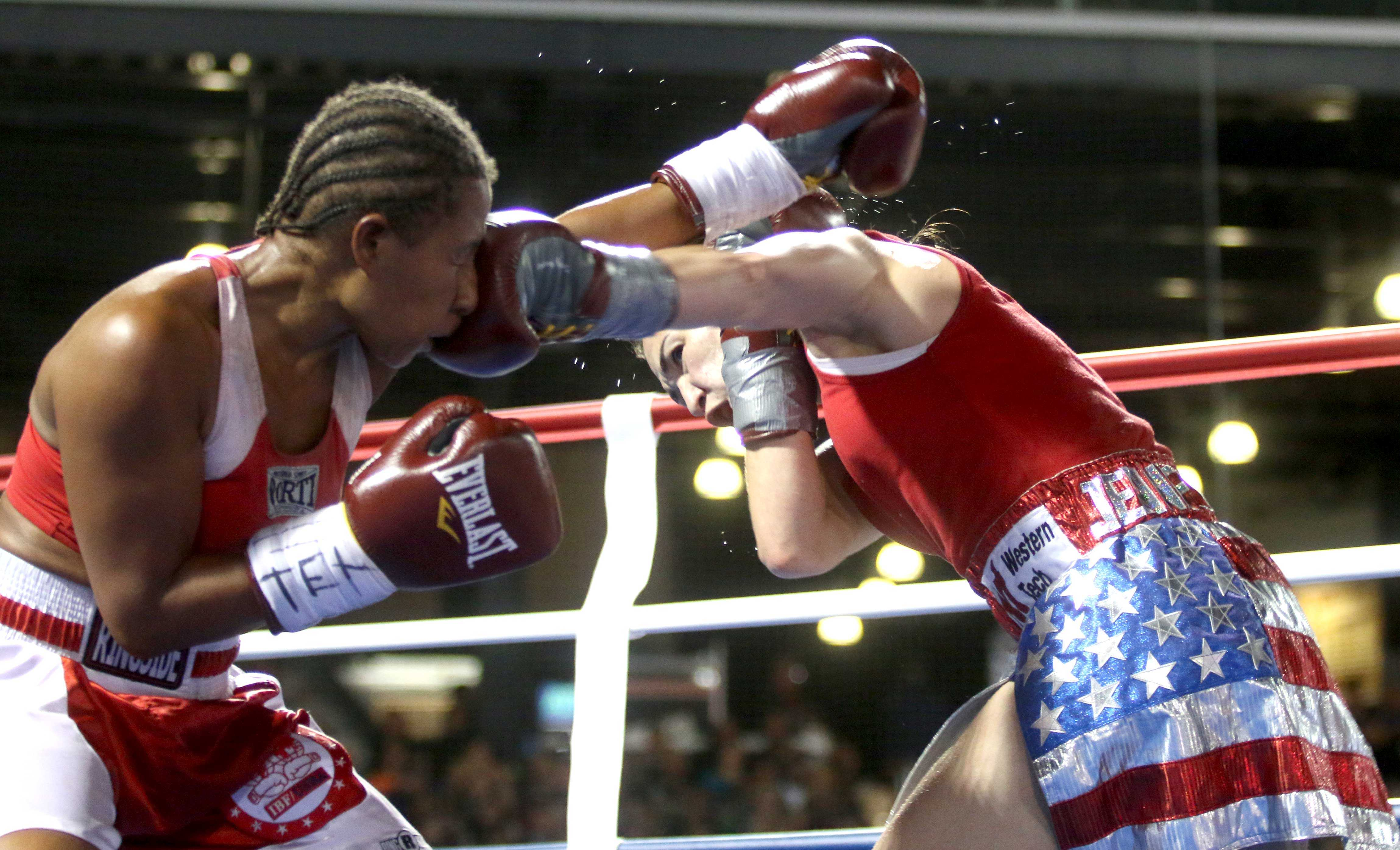 Jennifer Han (right) became El Paso's first boxing world champion in front of 1,500 fans at Southwest University Park on Apr. 30, 2016.
