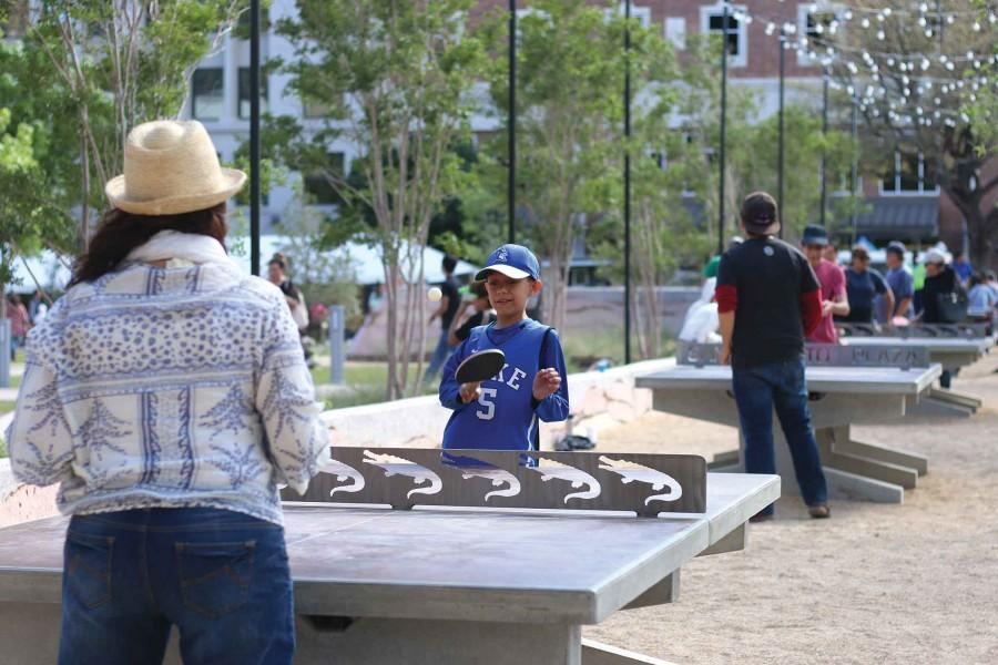Visitors enjoy playing a game of pong at the San Jacinto Plaza.