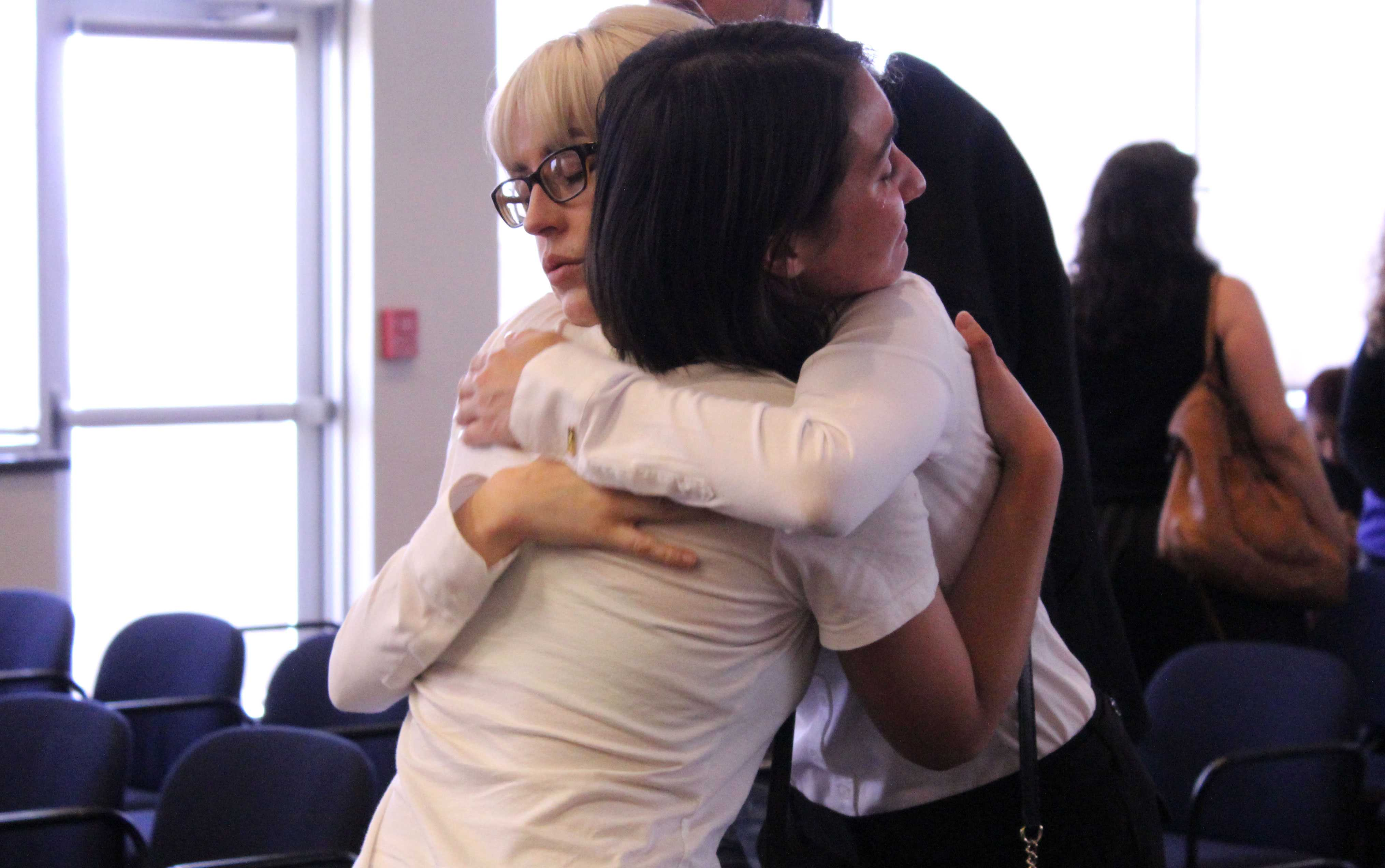 Melissa Stearns, close friend and P.A.S.S Session leader for Professor Foust, and former student console each other at Richard Foust's memorial service held at UTEP.