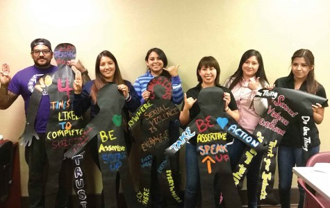 "Participants of the Silhouette Project hold up their decorated silhouettes as part of the month-long project that will begin April 11 at the Mercado Mayapan with the ""Fire & Ice Border Tour."""