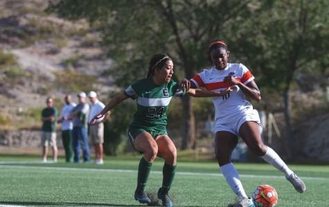 Junior defender Alexa Bain blacks the shot from Eastern New Mexico forward Erin McAnarney on Saturday, April 23.
