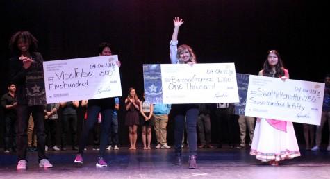 UTEP Picks Talent first place winner Berenice Gómez holds her $1,000 prize.