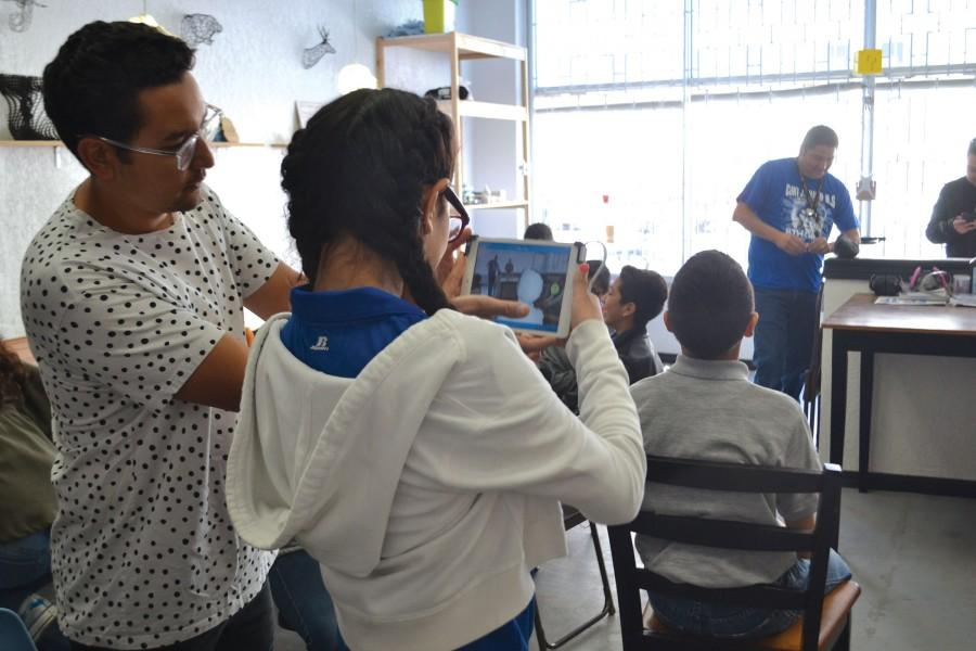 Executive Director Gustavo Arriaga shows a student from Clint Junior High School how the 3D-scanner at Fab Lab works. The lab is located at 806 Montana in central El Paso.