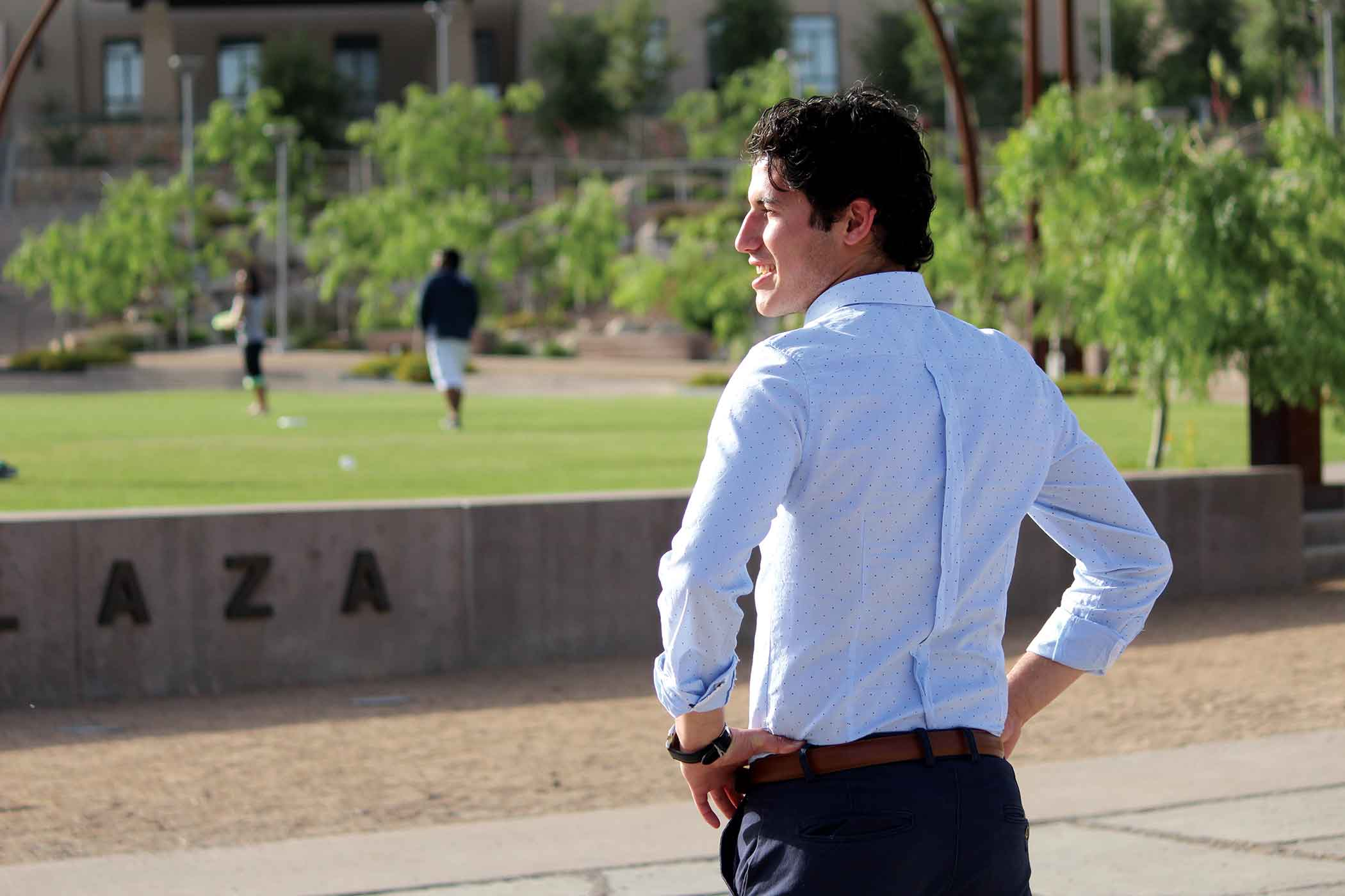 Newly elected Student Government Association president, sophomore operation chain supply management major Sergio Baltazar looks over the Centennial Plaza.