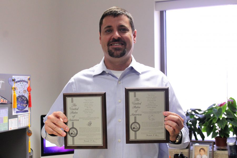 Marc Cox, Ph.D., associate professor at UTEP's Department of Biological Sciences, holds his 2016 Texas Inventor of the Year awards.
