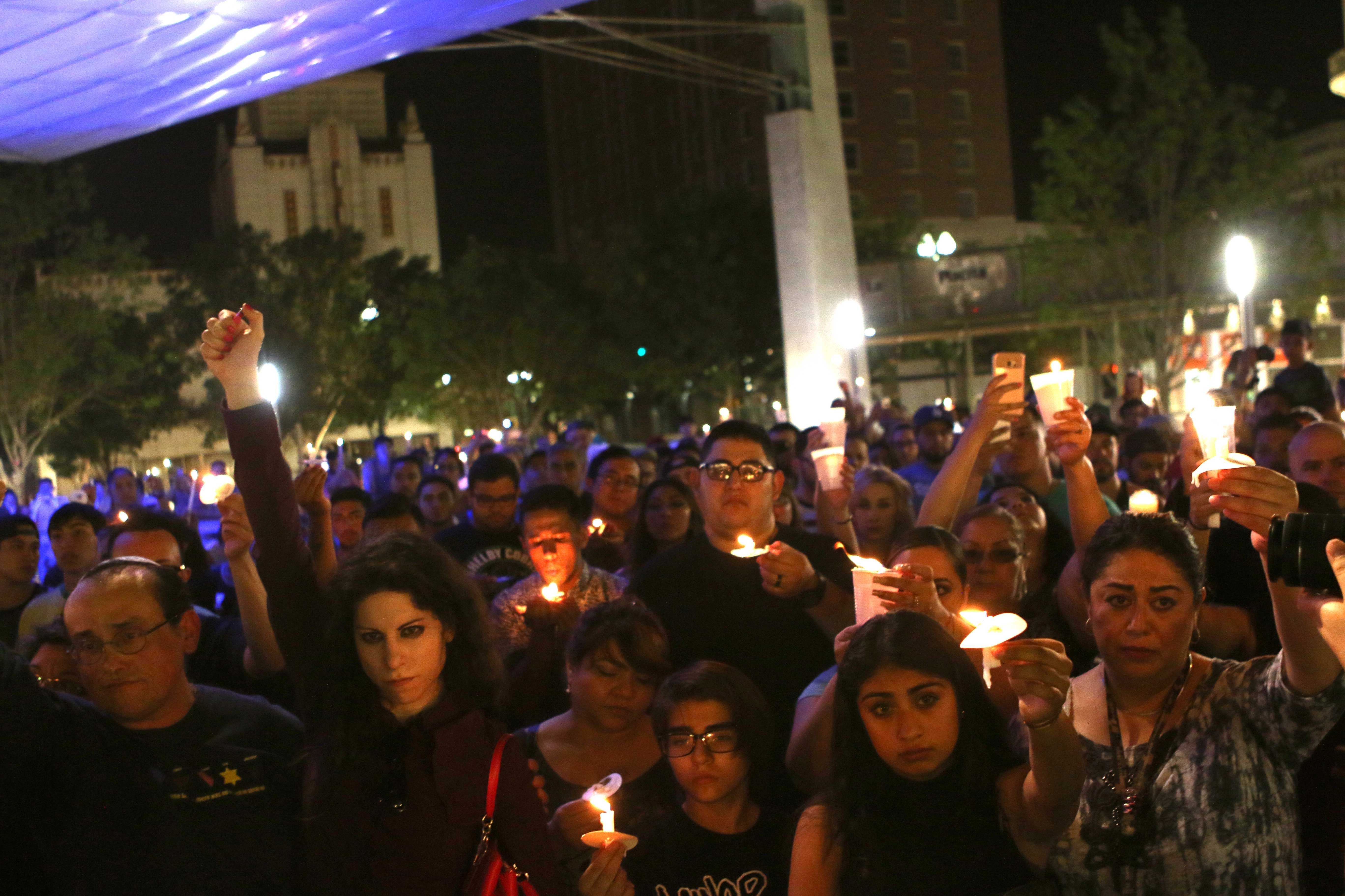 El Pasoans gather around San Jacinto Plaza to mourn the 50 lives lost in the Orlando night club shooting on Sun. June 12.