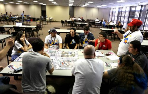 Boarder City Game Convention attendees play a zombie board game the second day of the convention.