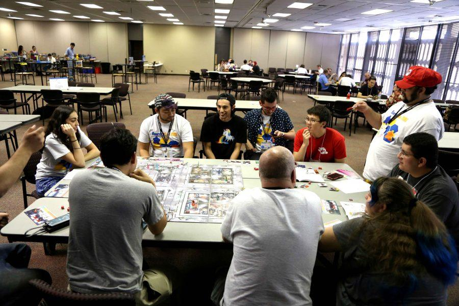 Boarder+City+Game+Convention+attendees+play+a+zombie+board+game+the+second+day+of+the+convention.+