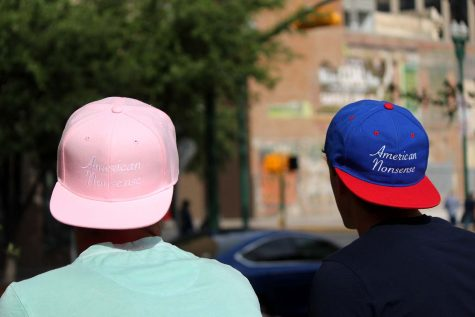Mike (left) wears the pink American Nonsense hat, which they had made to raise awareness on breast cancer.