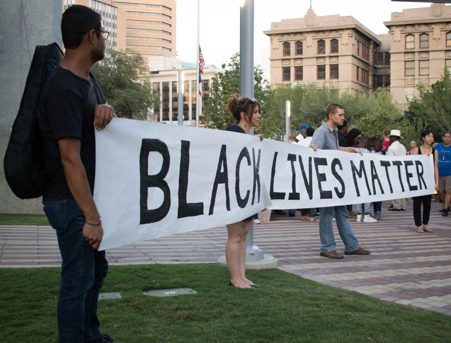 Citizens+of+El+Paso+hold+up+a+Black+Lives+Matter+banner+++at+San+Jacinto+Plaza.+