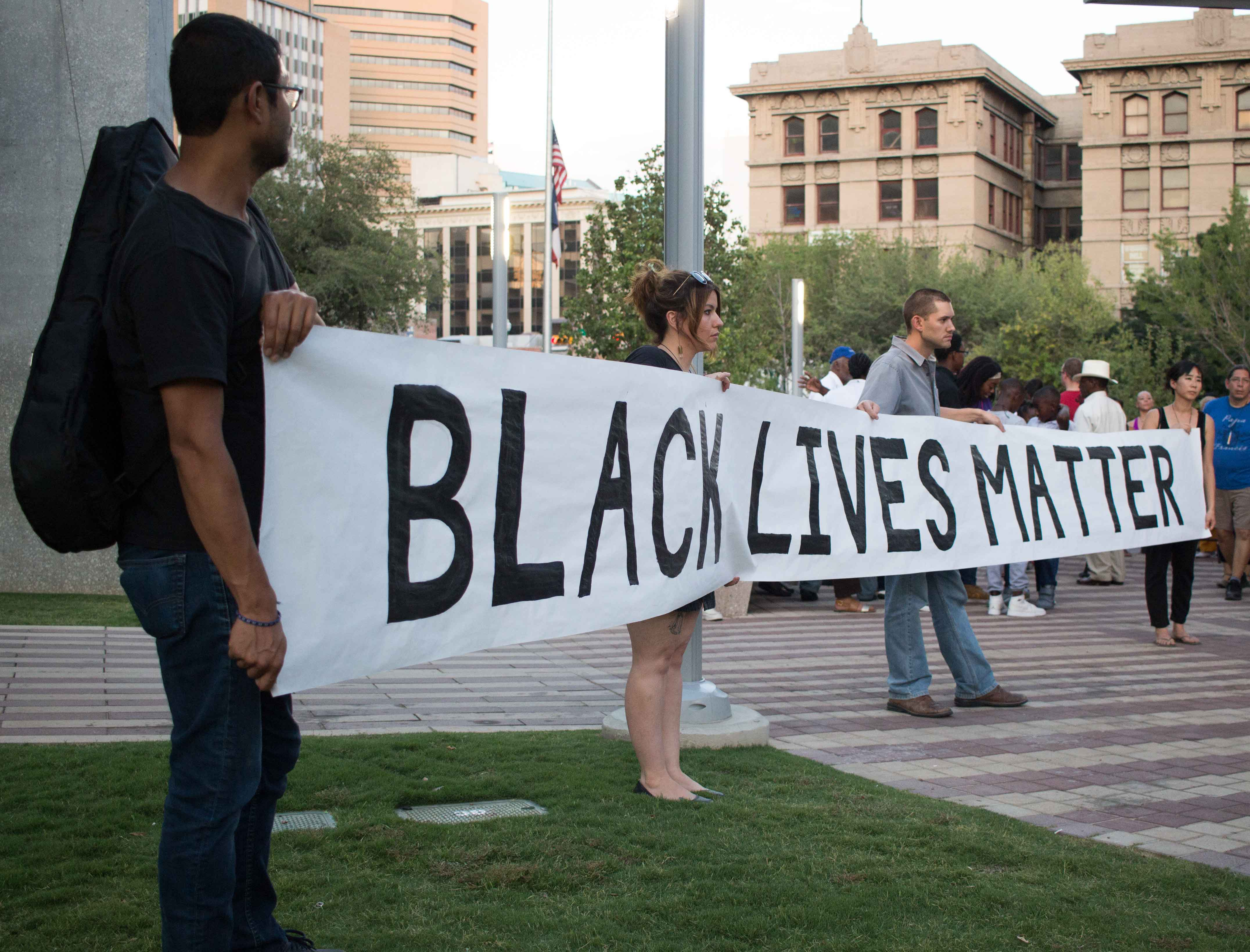 Citizens of El Paso hold up a Black Lives Matter banner   at San Jacinto Plaza.