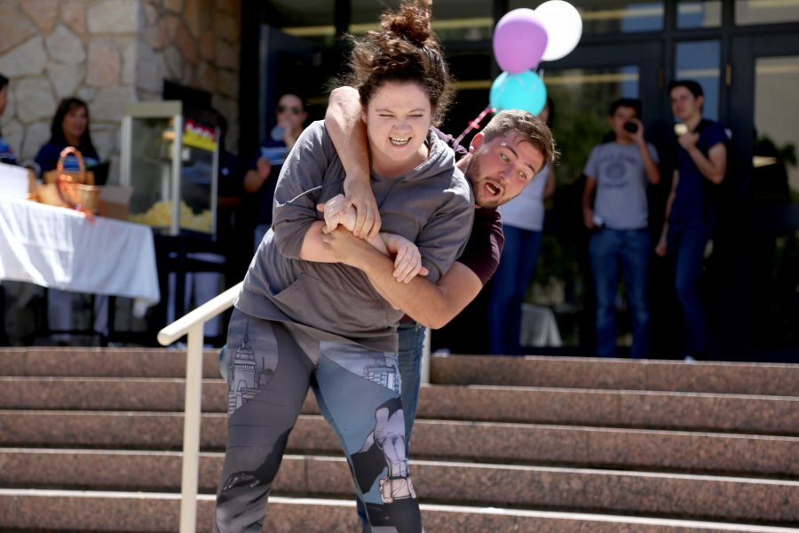 Sophomore theater major Jared Berry hops on the back of senior theater major Katherine Daniel as part of a sneak peak to upcoming play,
