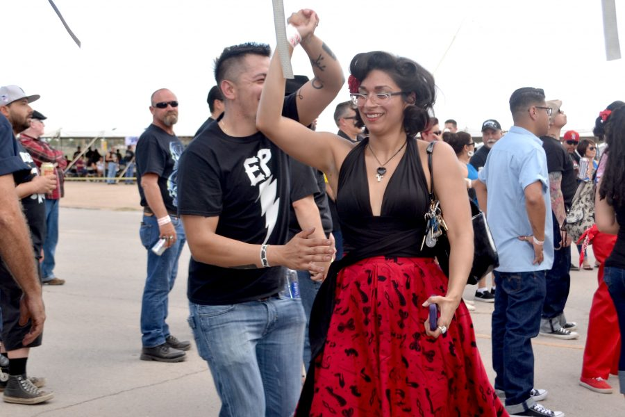Two festival goers swing to The Paladin. The band plays a country swing that allows dancers to triple step.